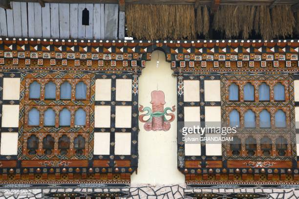 Bhutan District of Paro the road to Taktschang traditional house with painted phallus on a wall// Bhoutan district de Paro la ville maison...