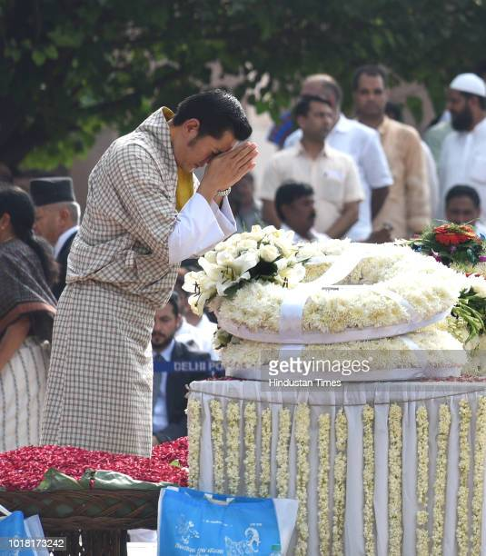 Bhutan King Jigme Khesar Namgyel Wangchuck pays his final respects during the cremation ceremony of former Prime Minister Late Atal Bihari Vajpayee...