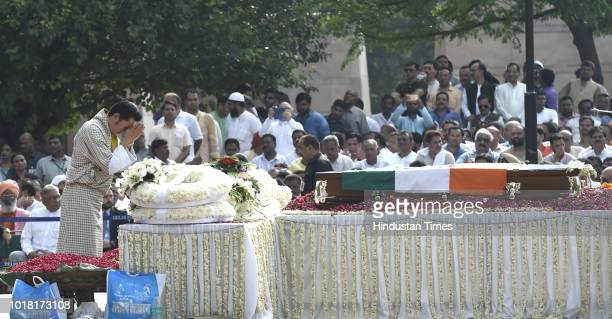 Bhutan King Jigme Khesar Namgyel Wangchuck pays his last respect during the funeral procession of former Prime Minister Atal Bihari Vajpayee at...