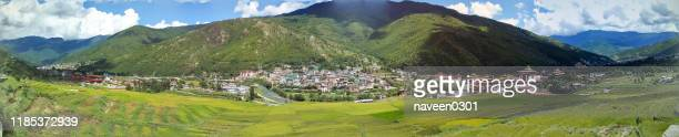 bhutan - pamoramic elevated view of thimphu city in bhutan - paro stock pictures, royalty-free photos & images