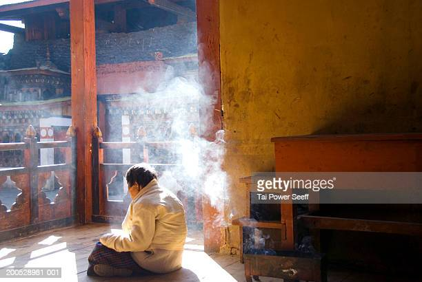 bhutan, thimpu, elderly woman begging for alms outside temple - thimphu stock pictures, royalty-free photos & images