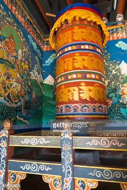 bhutan, trongsa. large, colourful buddhist prayer wheel and murals in trongsa dzong. - trongsa district stockfoto's en -beelden