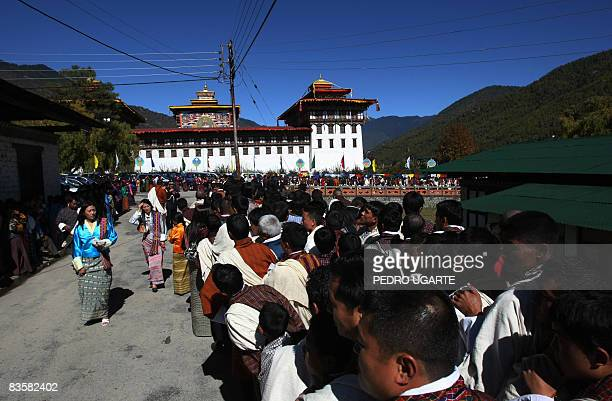 Bhutanase well-wishers wait to enter Taschichho Dzong Palace in Thimphu on November 6 to pay their respects to their new King Jigme Khesar Namgyel...