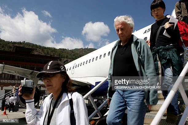 Bhutaneconomytourism BY Parul Gupta In this picture taken on March 19 2008 foreign tourists alight from a Druk Air plane at Paro airport in Paro The...