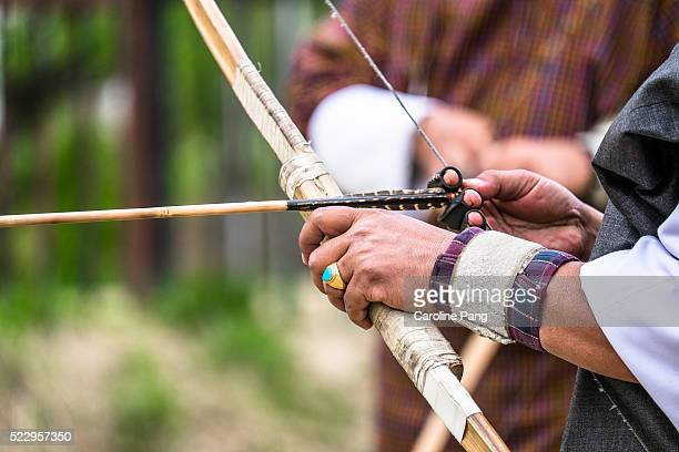 Bhutanese archer getting ready with his bow and arrow.