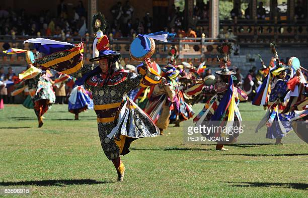 Bhutanese artists perform during a public ceremony to celebrate the crowning of Bhutan's King Jigme Khesar Namgyel Wangchuck in Thimphu on November 7...