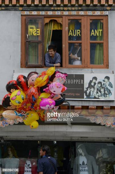 A Bhutanese balloon seller waits for customers in Thimpu on May 31 2017 Japanese Princess Mako is scheduled to arrive on a nineday official visit to...