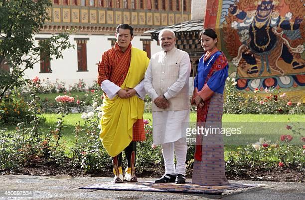 Bhutanese Bhunatese King Jigme Khesar Namgyel Wangchuck Indian Prime Minister Narendra Modi and Bhutanese Queen Jetsun Pema pose for a photograph...