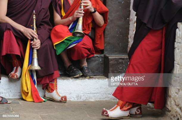 Bhutanese Buddhist monks wait to receive Japanese Princess Mako inside Rinpung Dzong on the outskirts of Paro on June 5 2017 Japanese Princess Mako...