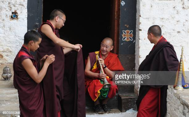 Bhutanese Buddhist monks wait to receive Japanese Princess Mako inside Rinpung Dzong on the outskirts of Paro on June 5 2017 Japanese Princess Mako...
