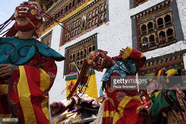 Bhutanese dancers perform at the annual Paro Tsechu festival on March 21, 2008 in Paro, Bhutan. The festival is a tradtional religious Bhutanese...