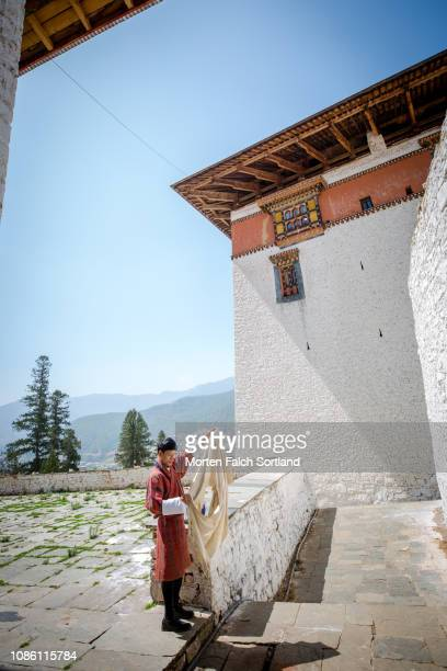 bhutanese holding a piece of cloth in paro, bhutan - paro stock pictures, royalty-free photos & images