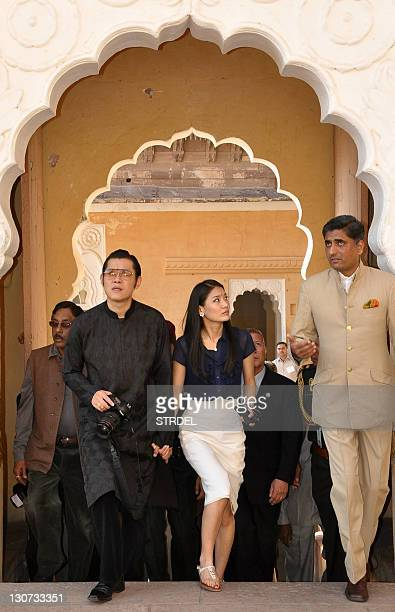 Bhutanese King Jigme Khesar Namgyel Wangchuk and his wife Queen Jetsun Pema speak with officials as they visit Mehrangarh Fort in Jodhpur on October...