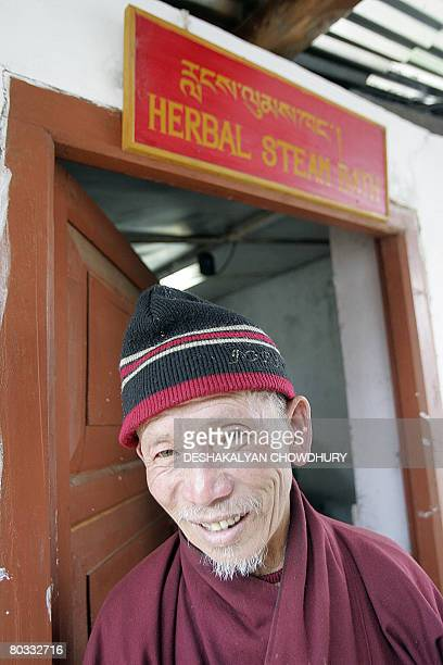 A Bhutanese man gestures as he comes out taking a Herbal Steam Bath at an Indigenious Hospital in Thimphu on March 21 2008 The tiny Himalayan kingdom...