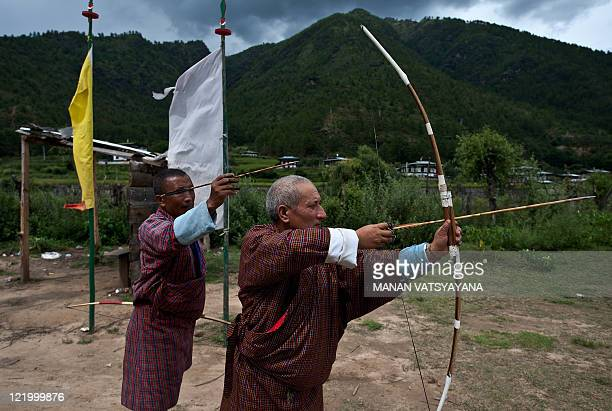 A Bhutanese man mocks an opponent during a game of archery on a field in Paro on August 21 2011 Archery an ancient traditional sport is Bhutan's...