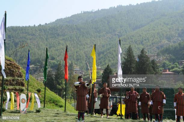 A Bhutanese man shoots an arrow in presence of Japan's Princess Mako at the Changlingmethang National Archery ground in Thimphu on June 3 2017...