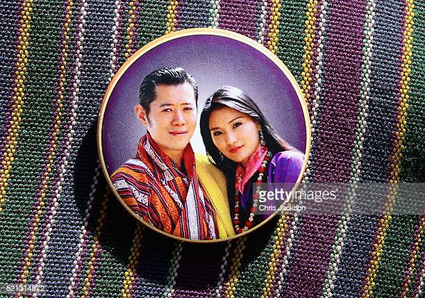 A Bhutanese man wears a badge featuring the King and Queen of Bhutan near Tiger's Nest on the 15th April 2016 in Thimphu Bhutan The Royal couple are...