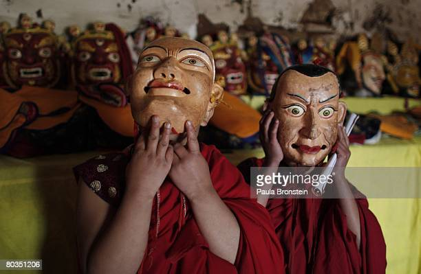 Bhutanese monk dancers try on their masks before performing at the annual Paro Tsechu festival on March 20, 2008 in Paro, Bhutan. The festival is a...