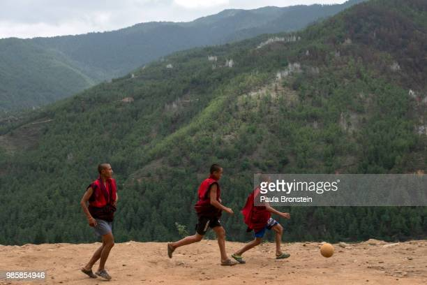 Bhutanese monks play soccer during their free time at the Dechen Phodrang monastery on June 14 in Thimphu, Bhutan. Around 250 monks reside at the...