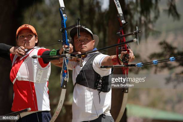 Bhutanese Olympic archers Dorji Dolma and her husband Tashi Tshering practice at the team training ground March 31 2008 in Thimphu Bhutan Both are...