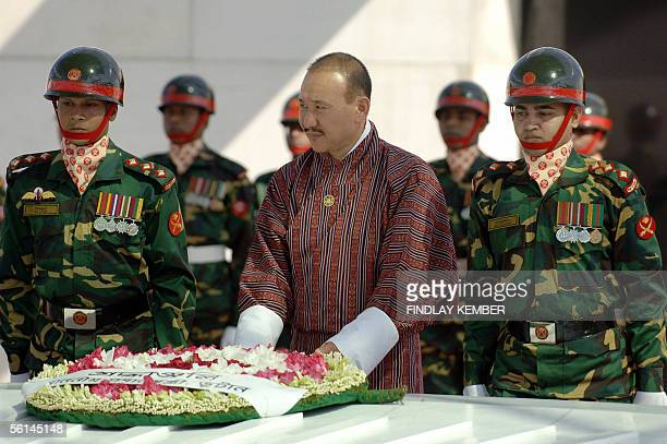 Bhutanese Prime Minister Lyonpo Jigmi Y Thinley is assisted by Bangladeshi soldiers as he lays a wreath at The Mazar of Shaheed President Ziaur...