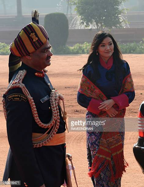 Bhutanese Queen Jetsun Pema Wangchuck walks during the welcome ceremony at the Presidential Palace in New Delhi on January 25 2013 The King of Bhutan...