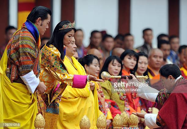 Bhutanese royal couple King Jigme Khesar Namgyel Wangchuck and Queen Jetsun Pema perform rituals during a ceremony in Thimphu on October 15 2011...