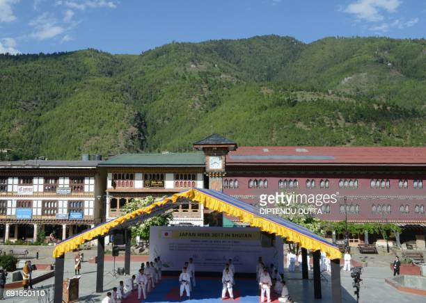 Bhutanese students perform karate during the opening ceremony for 'Japan Week', attended by Japanese Princess Mako, in Thimpu on June 2, 2017....
