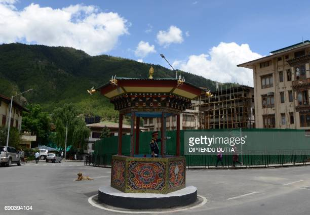 A Bhutanese traffic guard directs vehicles at a junction in Thimpu on May 31 2017 Japanese Princess Mako is scheduled to arrive on a nineday official...