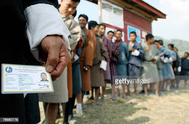 Bhutanese voters wait to cast their votes in Phuentisiling constituency some 45 Kms from the IndoBhutan border 31 December 2007 The isolated...