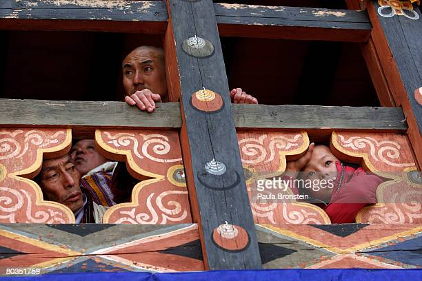 Bhutanese watch as dancers perform at the annual Paro Tsechu festival March 21, 2008 in Paro, Bhutan. The festival is a tradtional religious...