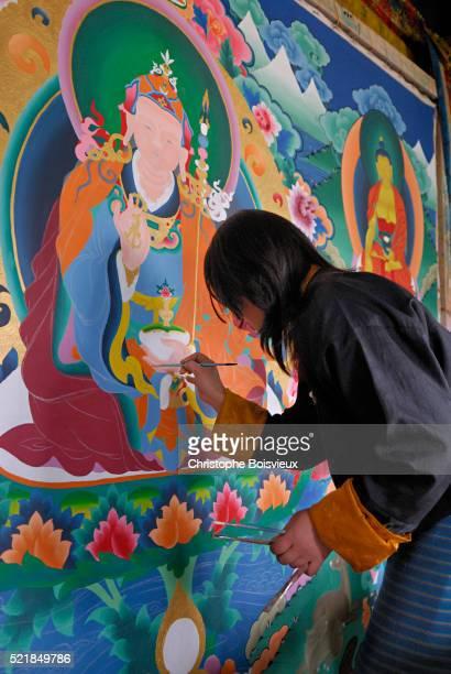 Bhutanese Woman Painting Buddhist Mural