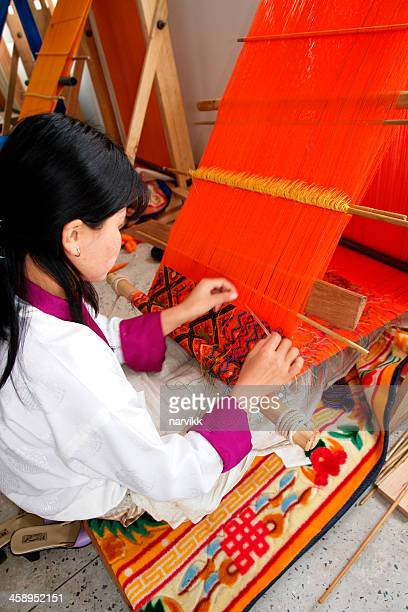 bhutanese woman weaving hand made rug - bhutan stock pictures, royalty-free photos & images