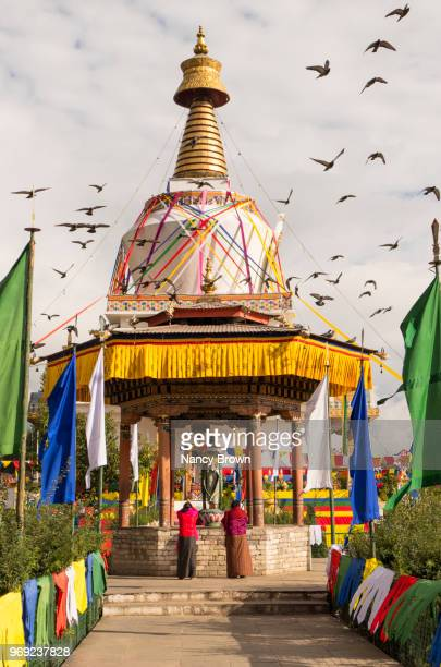 bhutanese women worshipping in bhutan. - thimphu stock pictures, royalty-free photos & images