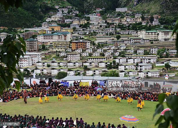 BhutanpoliticseconomyhealthlaboursocialyouthFEATURE by Rachel O Bhutanese school teenagers perform a dance during a cultural event to celebrate the...
