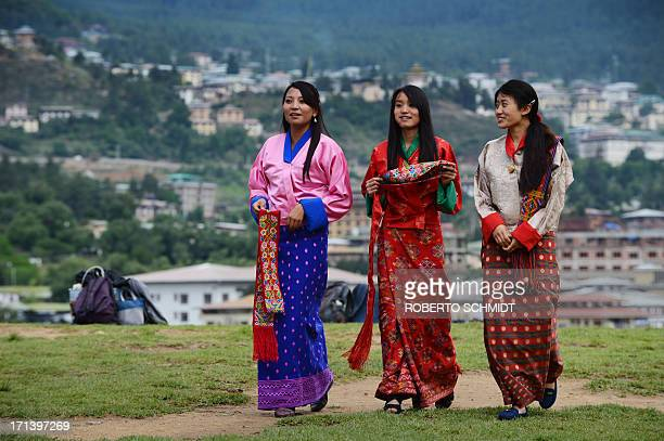 BhutanpoliticseconomyhealthlaboursocialyouthFEATURE by Rachel O Schoolgirls wear traditional Bhutanese dresses before a cultural event to celebrate...
