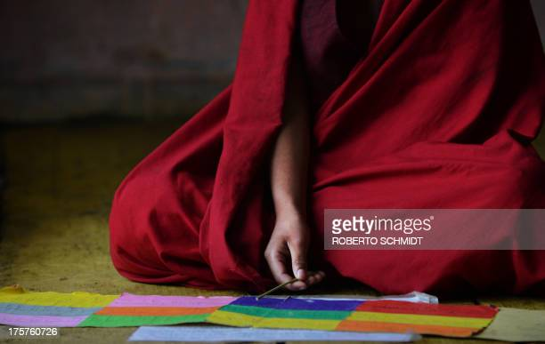 Bhutan-religion-society-Buddhism-monks,FEATURE by Rachel O'BRIEN In this photo taken on June 4, 2013 a young Buddhist monk starts to learn a holy...