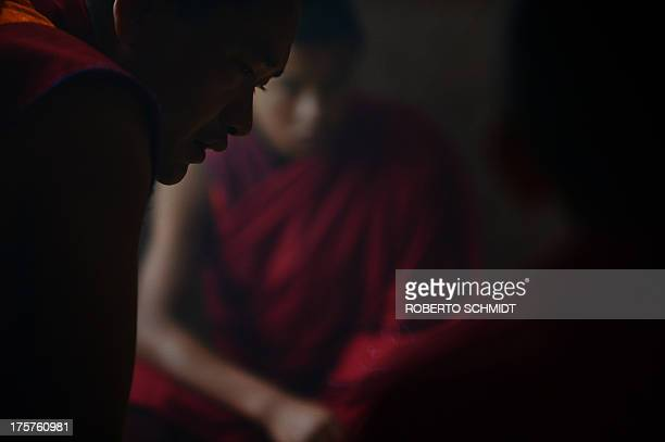 BhutanreligionsocietyBuddhismmonksFEATURE by Rachel O In this photo taken on June 4 2013 a monk teacher instructs young monks about committing...