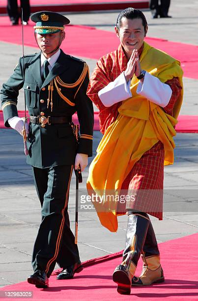 Bhutan's King Jigme Khesar Namgyal Wangchuck attends a welcoming ceremony at the Imperial Palace in Tokyo on November 16 2011 Bhutan's royal couple...