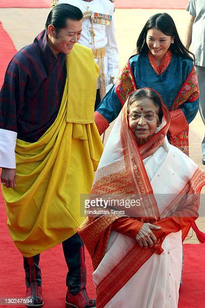 Bhutan's King Jigme Khesar Namgyel Wangchuck and Queen Jetsun Pema are received by President Pratibha Devisingh Patil for a ceremonial reception at...