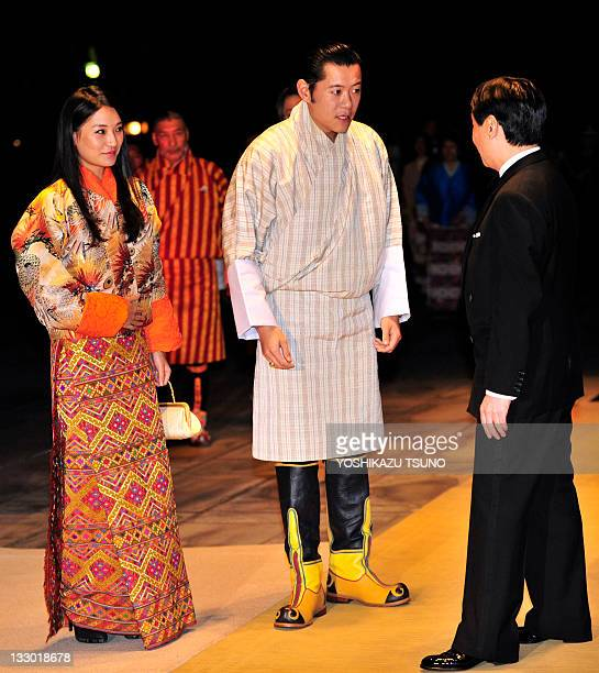 Bhutan's King Jigme Khesar Namgyel Wangchuck and Queen Jetsun Pema are greeted by Japanese Crown Prince Naruhito upon their arrival at the Imperial...