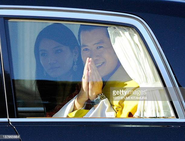 Bhutan's King Jigme Khesar Namgyel Wangchuck and Queen Jetsun Pema leave the Imperial Palace after their welcoming ceremony in Tokyo on November 16...