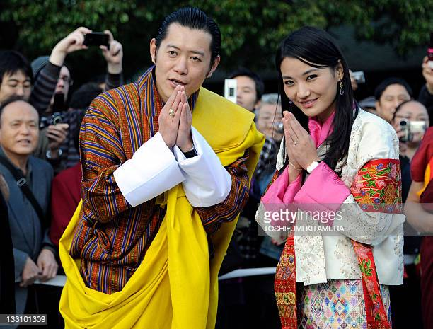 Bhutan's King Jigme Khesar Namgyel Wangchuck and Queen Jetsun Pema greet guests during a visit to the Meiji shrine in Tokyo on November 17 2011...