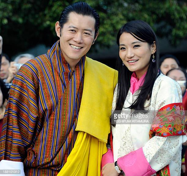 Bhutan's King Jigme Khesar Namgyel Wangchuck and Queen Jetsun Pema pose for photographers during a visit to the Meiji shrine in Tokyo on November 17...
