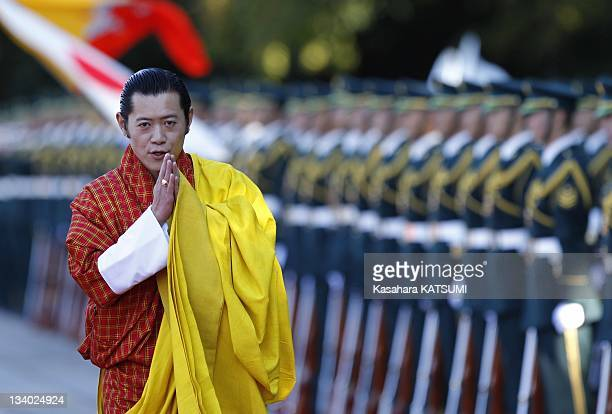 Bhutan's King Jigme Khesar Namgyel Wangchuck greets after inspecting an honour guard during a welcome ceremony at the Imperial Palace on November 16...