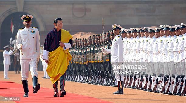 Bhutan's King Jigme Khesar Namgyel Wangchuck inspects the guard of honour during a ceremonial reception at the Presidential Palace in New Delhi on...