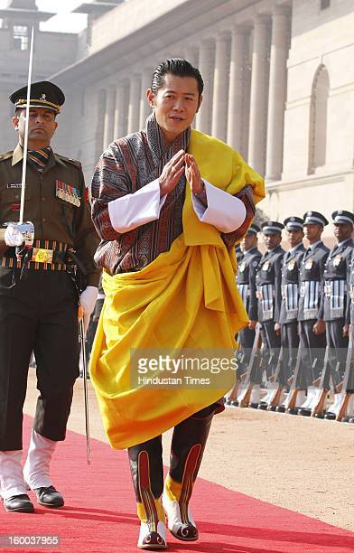 Bhutan's King Jigme Khesar Namgyel Wangchuck, inspects the guard of honour during the ceremonial reception of Bhutan's King on January 25, 2013 in...