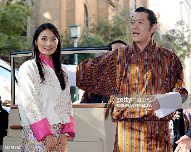 Bhutan's King Jigme Khesar Namgyel Wangchuck introduces Queen Jetsun Pema upon their arrival at the Keio University to receive the degree of Doctor...