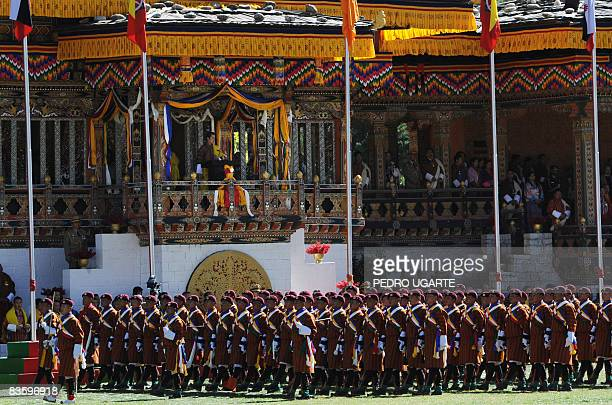 Bhutan's King Jigme Khesar Namgyel Wangchuck watches a military parade from a balcony during a public ceremony in Thimphu on November 7 2008 Bhutan's...