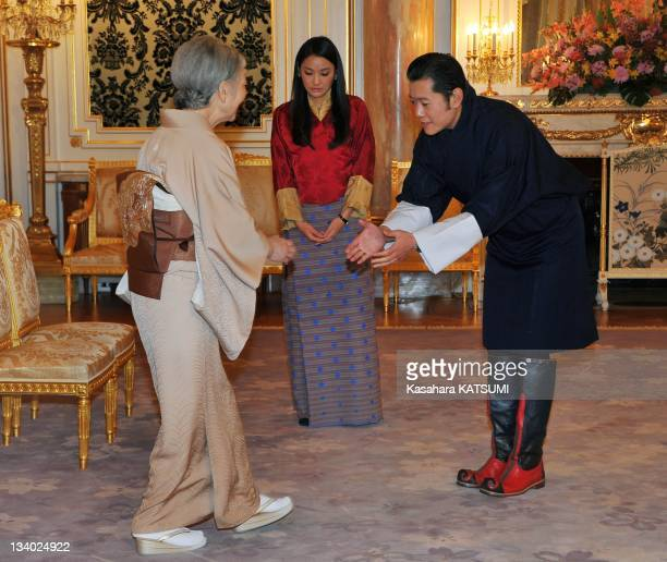 Bhutan's King Jigme Khesar Namgyel Wangehuk and Queen Jetsun Pema welcome Japan's Empress Michiko during her call at the Akasaka guest house on...